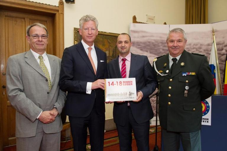 The authors of the book with the Minister : Major Rob Troubleyn, First Sergeant-Chief Malek Azoug and Adjudant Patrick Brion